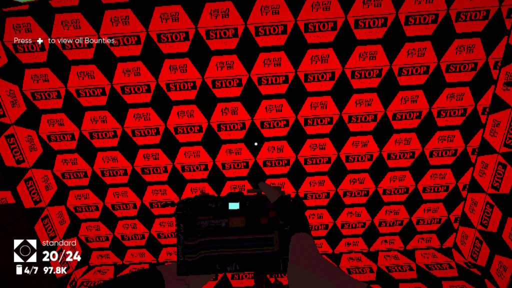 A wall of red hexagonal signs each reading 'Stay' (Tíngliú) in Chinese characters and 'Stop' in the Roman alphabet.